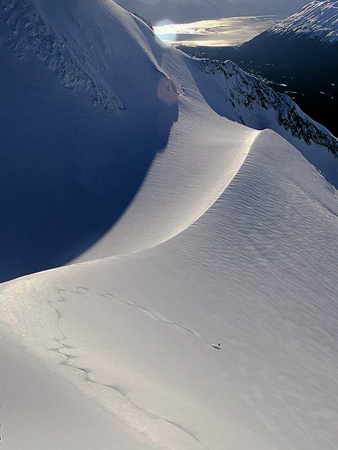 A Heli-Skier Takes a Creative Descent on the Last Run of the Day Photographic Print by Ben Horton