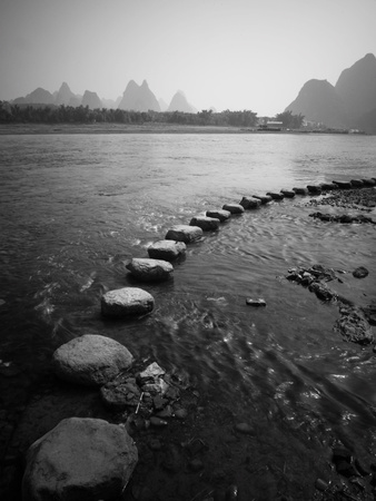 A Stone Pathway Crosses the River in Guilin, China Photographic Print by Ben Horton