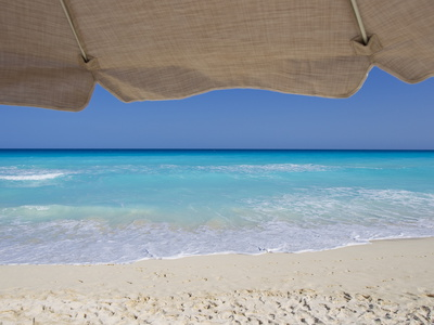 View of Turquoise Waters from Underneath a Beach Umbrella Photographic Print