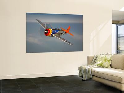 A Republic P-47D Thunderbolt in Flight Wall Mural by  Stocktrek Images