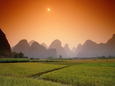 Rice fields an chalk mountains at twilight, Yangshou, Guangxi Province, China Photographic Print