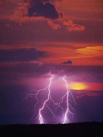 Lightning Storm at Sunset Photographic Print by Jim Zuckerman