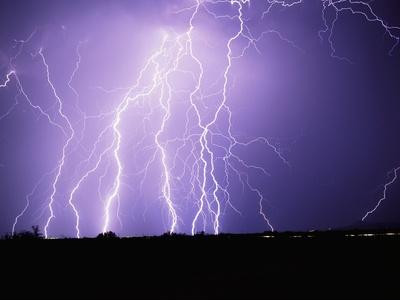 Lightning Striking the Ground Photographic Print by Warren Faidley
