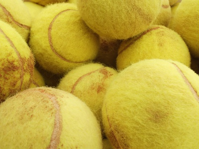 Tennis balls Photographic Print by Gregor Schuster