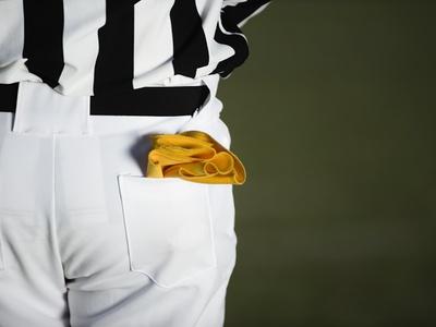 Referee with Penalty Flag in Pocket Fotoprint av Robert Michael