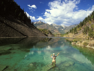 Young Man Fly-fishing on Lower Silver Springs Lake in the Elk Valley Near Fernie, British Columbia, Photographie