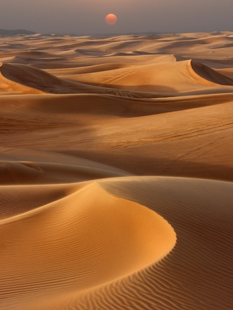 Sunset over the sand dunes in Dubai Photographic Print by Jon Bower