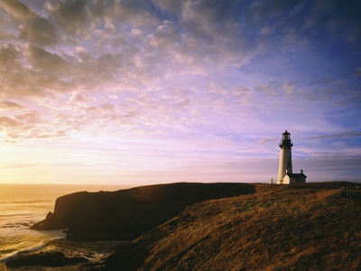Sun Rising over Yaquina Head Lighthouse Photographic Print
