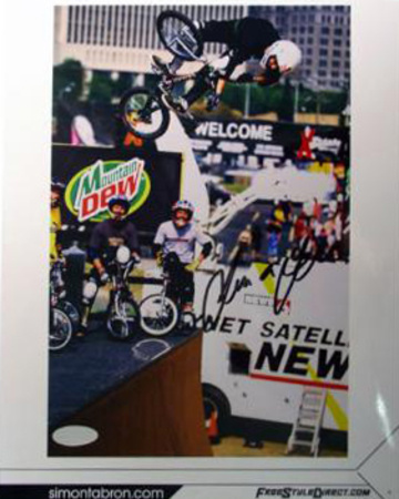 Simon Tabron M Dew Sign Biking Photo
