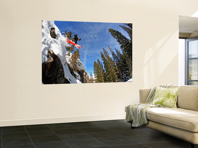 Skier Jumping Off Small Cliff at Brighton Ski Resort Posters af Paul Kennedy