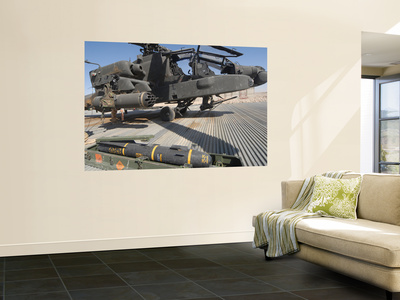 An AGM-114 Hellfire Missile Is Ready to Be Loaded onto an AH-64 Apache Poster by  Stocktrek Images