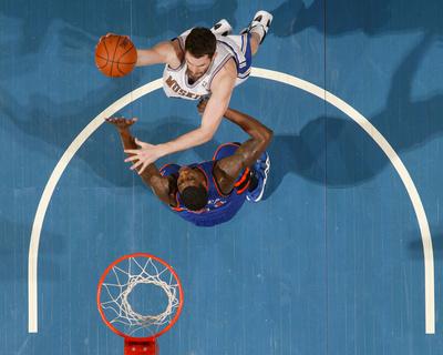 New York Knicks v Minneapolis Timberwolves, Minneapolis, MN, Feb 11: Kevin Love, Iman Shumpert Photo by David Sherman