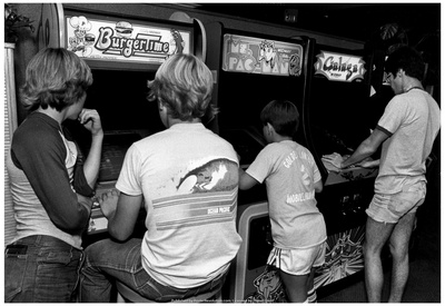 Photo of kids playing arcade games in Florida, archival video game photo
