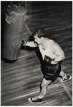 Rocky Marciano punching a boxing bag, archive boxing photo print poster