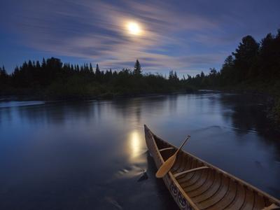 Moonlight Bathes a Birchbark Canoe on Maine's Allagash River Photographic Print by Michael Melford