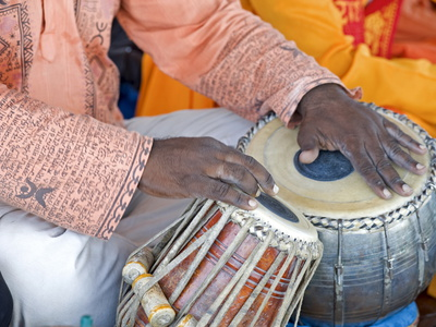 Hindu Musician Playing the Tabla (Drums) with Typical Black Spot Made from a Mixture of Gum, Soot a Photographic Print by Annie Owen