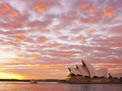Australia, New South Wales, Sydney, Sydney Opera House, Boat in Harbour at Sunrise Photographic Print by Shaun Egan