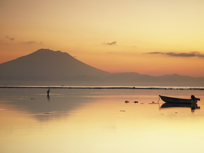 Fisherman Standing in Sea with Mount Agung in the Background, Sanur, Bali, Indonesia Photographic Print by Ian Trower