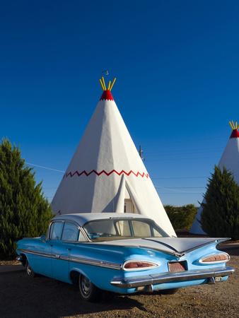 USA, Arizona, Holbrook, Route 66, Wigwam Motel, Chevrolet Impala Photographic Print by Alan Copson