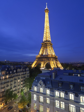 France, Paris, Eiffel Tower, Viewed over Rooftops at Night Photographic Print by Gavin Hellier