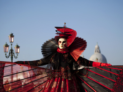 Venice, Veneto, Italy, a Mask in Costume on the Bacino Di San Marco with the Cupola of Santa Maria  Photographic Print by Ken Scicluna