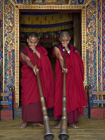 Two Monks Blow Long Horns Called Dung-Chen, at the Temple of Wangdue Phodrang Dzong (Fortress) Photographic Print by Nigel Pavitt