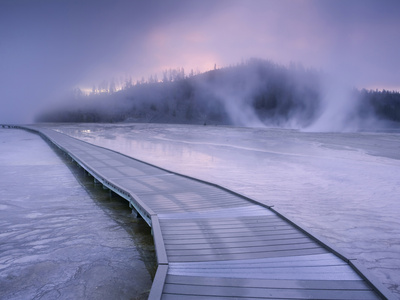 Boardwalk in the Morning Fog and Mist around Grand Prismatic Spring in Yellowstone National Park Photographic Print by David Cobb
