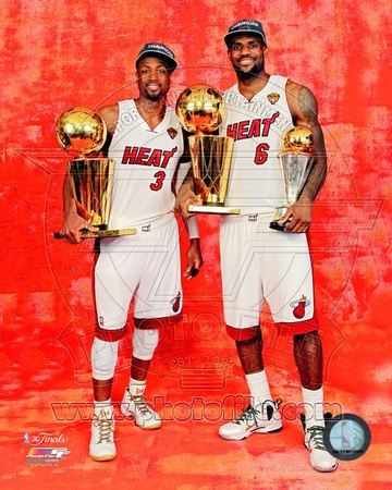 LeBron James & Dwyane Wade with the 2012 NBA Finals & MVP Trophies Game 5 of the 2012 NBA Finals Photo