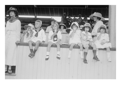 Children Sit on Wall in Front of Stands at the Ballpark and Eat Ice Cream Cones. Prints