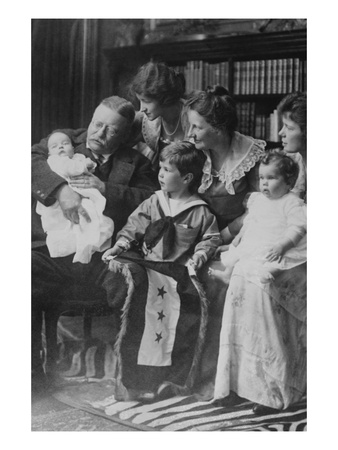 Teddy Roosevelt Holds a Baby in His Arms in a Family Portrait Posters