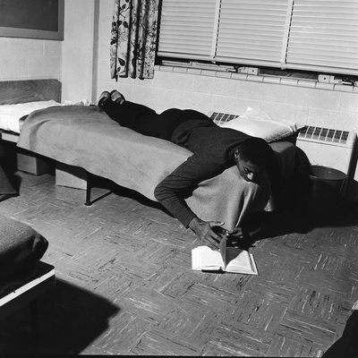 Basketball Great Wilt Chamberlain Relaxes with a Book, 1957 Photographic Print by David W. Jackson