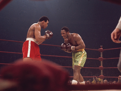 """Muhammad Ali and Joe Frazier, """"Fight of the Year"""", March 8, 1971 Photographic Print by Moneta Sleet"""
