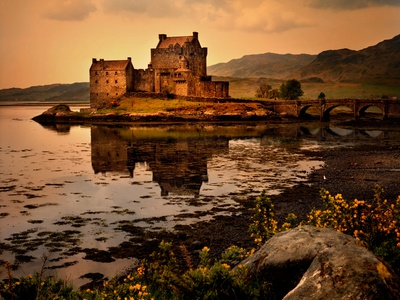 An Ancient Castle Beside a Loch in Scotland Photographic Print by Jody Miller