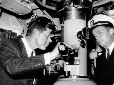 President John Kennedy Looks Through the Periscope of the Nuclear Submarine USS Thomas A Edison Photo