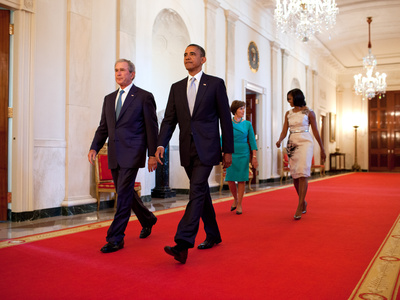 President Barack Obama and First Lady Michelle Obama Walk with Former President George W Bush Photo