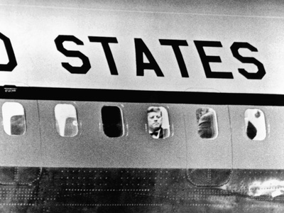 President John Kennedy Peers Out from Window of Air Force One Photo