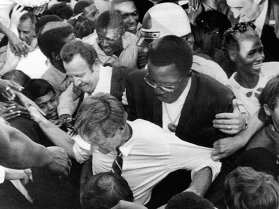 Sen Robert Kennedy Tugged at from Every Direction Photo