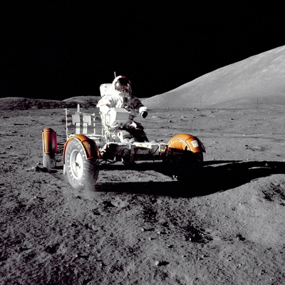 Apollo 17 Astronaut Eugene a Cernan Driving the Lunar Rover Photo