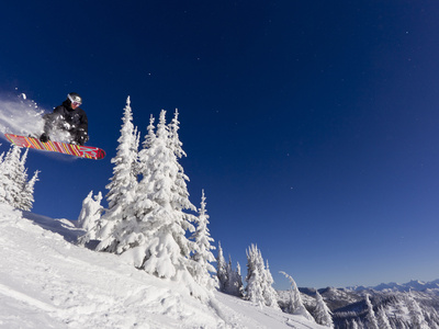 Snowboarding Action at Whitefish Mountain Resort in Whitefish, Montana, USA Photographic Print by Chuck Haney