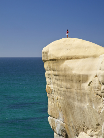 Tourist on Cliff Top at Tunnel Beach, Dunedin, South Island, New Zealand Photographic Print by David Wall