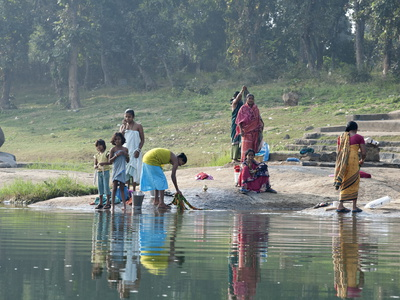 Women Washing Clothes on the Ghats of the River Mahanadi, Reflected in the Water, Orissa, Inda Photographic Print by Annie Owen