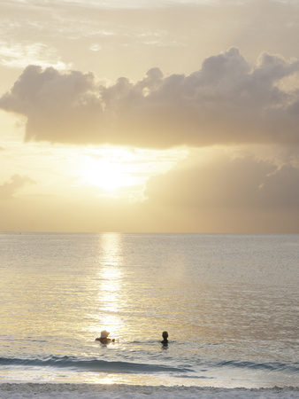 Two Swimmers in Ocean at Sunset, Grace Bay, Providenciales, Turks and Caicos, West Indies Photographic Print by Kim Walker
