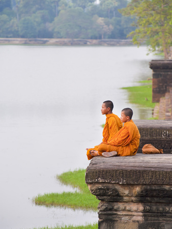 Buddhist Monks Sitting at Angkor Wat Temple, Angkor, UNESCO World Heritage Site, Cambodia Photographic Print by Matthew Williams-Ellis