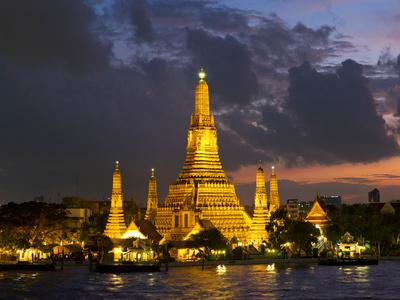 Buddhist Temple Lit Up at Dawn, Wat Arun, Chao Phraya River, Bangkok, Thailand Photographic Print by  Panoramic Images