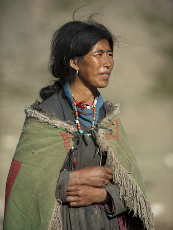 A Nomad Woman Tends to Her Sheep and Goats Photographic Print by Alex Treadway