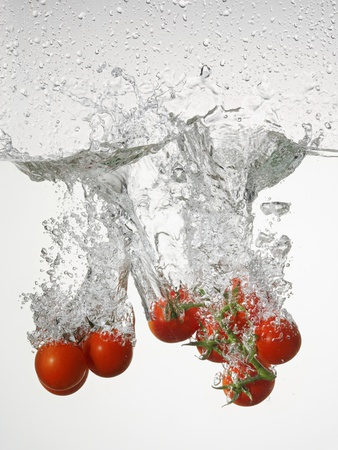 Tomatoes Falling into Water Photographic Print by  Kröger & Gross