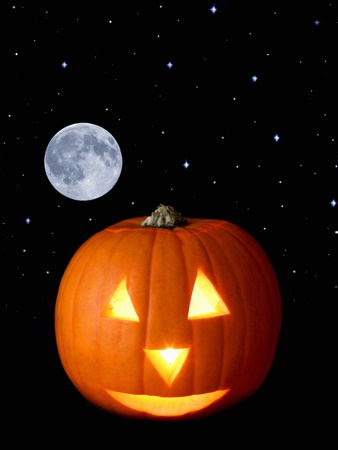 A Halloween Pumpkin with Moon and Stars in Background Photographic Print by Steven Morris