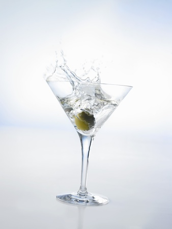 Martini with Green Olive (Splash) Photographic Print by Klaus Arras