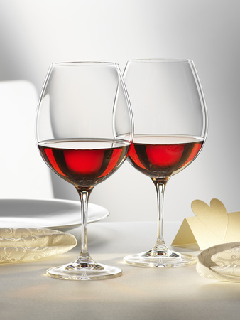 Two Glasses of Red Wine on Festive Table Photographic Print by Alexander Feig