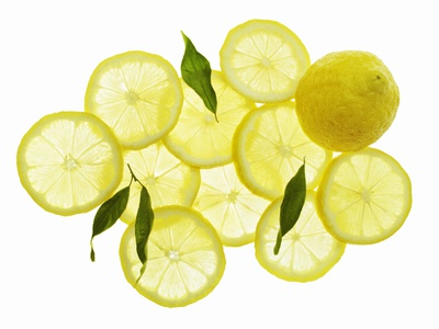A Whole Lemon, Lemon Slices and Leaves Photographic Print by Petr Gross